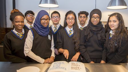 Vinitha Vasantharajah cuts the cake with fellow pupils from Kingsbury High School after their book S