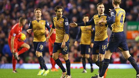 Aaron Ramsey of Arsenal celebrates scoring his team's first goal at Anfield. (Photo by Alex Livesey