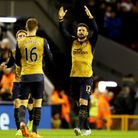 Olivier Giroud (right) celebrates his first goal of the game against Liverpool