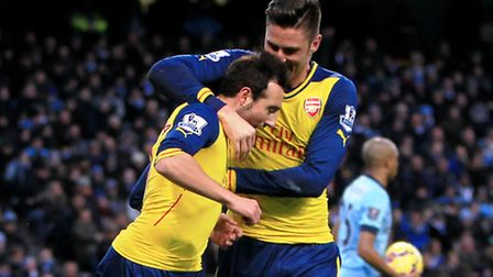 Santi Cazorla and Olivier Giroud celebrate Arsenal's 2-0 win over Manchester City at the Etihad Stad