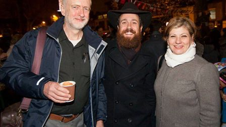 Jeremy Corbyn and Emily Thornberry, with Rabbi Mendy Korer, at the Jewish festival of lights ceremon