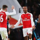 Theo Walcott of Arsenal celebrates scoring his team's first goal (Photo by Clive Rose/Getty Images)