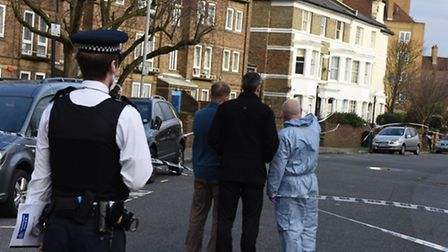 Police pictured in Hilldrop Crescent, Holloway, this morning