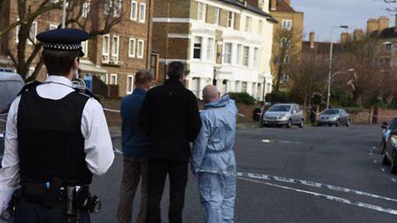 Police at the scene in Hilldrop Crescent, Holloway, this morning