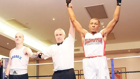 Islington BC's Aaron Nicely (right) celebrates victory against Emmanuel Tosatto at the club's dinner