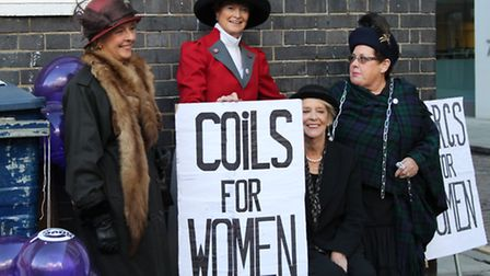 Women dressed as suffragettes protest outside the Margaret Pyke Centre which is threatened with clos