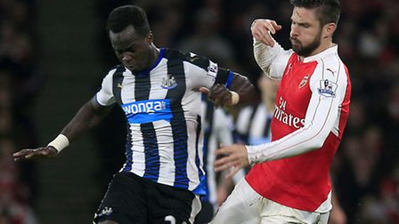 Olivier Giroud battles with Newcastle United's Cheick Tiote (left) during Saturday's game