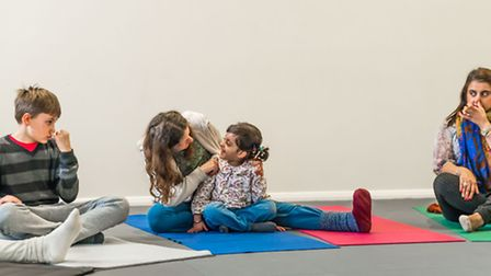 Denisa Nenova teaching yoga to students at her centre in Holloway