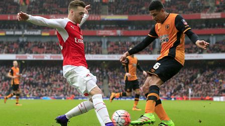 Hull City's Curtis Davies and Arsenal's Calum Chambers (left) battle for the ball during their 0-0 d
