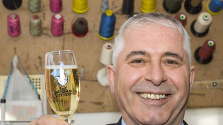 Mehmet Ozer celebrates his �303,465.20 EuroMillions win at his workshop in Caledonian Road, Islingto