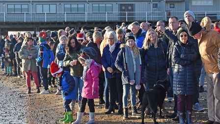 Spectators watch on at the Christmas Day swim in Lowestoft 2019. Pictures: Mick Howes