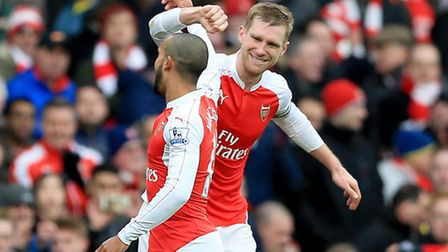 Arsenal's Theo Walcott and Per Mertesacker (right) celebrate after the final whistle against Leicest