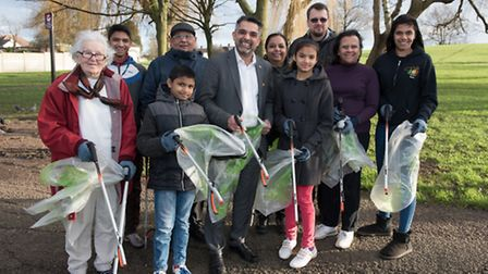 Cllr Muhammed Butt, leader of Brent Council, centre, with member of the community