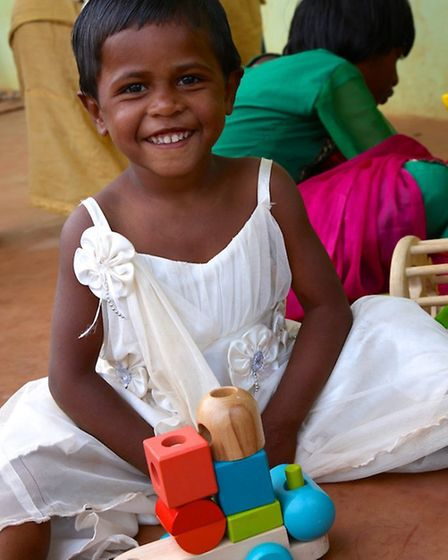 A child at the Astha orphanage in the tribal region of Koraput, Orissa with a donated toy