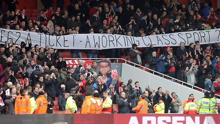 Liverpool fans display signs protesting ticket prices in the stands at Arsenal before kick-off. Pict