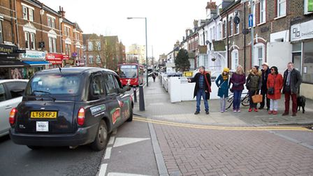 """Protesters tell a duped taxi driver """"Don't turn right!"""" (Pic: Adam Tiernan Thomas)"""