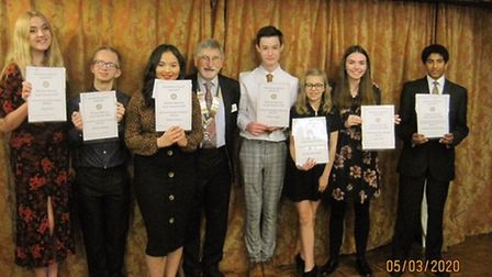 The winners, photographed with Rotary Club President John Hunt are, left to right, Daisy Dua, Connor