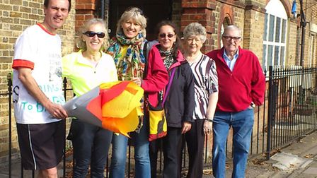 Paul Lorber and fellow Friends of Barham Library campaigners outside the new premises in Harrow Road
