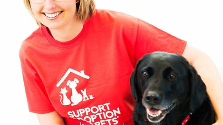 Amy Wilson, charity manager at Support Adoption For Pets with Mackie as �4,000 and �10,000 grants ar