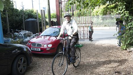 Jeremy Corbyn arrives by bicycle in summer last year to launch his policies on the environment at Ca