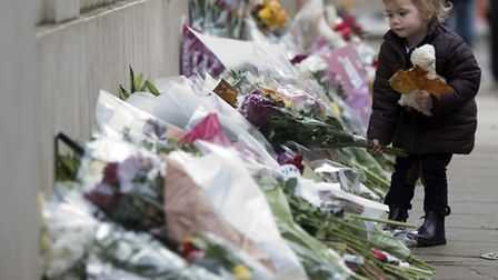 Flowers at the scene in Paris (Pic: PA)