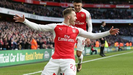 Arsenal's Calum Chambers celebrates after scoring against Burnley