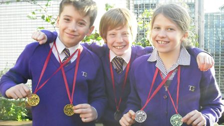 The Gower School pupils Cy Sherliker, eight, Joseph Glaser, nine, and Persephone Holloway, 10, were