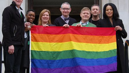 Cllr Claudia Webbe (far right) and Islington Council staff with the rainbow flag, to mark the start