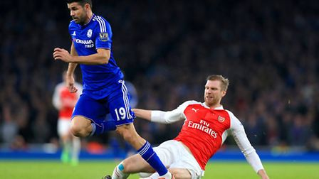 Arsenal's Per Mertesacker tackles Chelsea's Diego Costa, resulting in a red card. Picture: Adam Davy