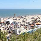 A crowded beach at Lowestoft's First Light Festival. Could you support the Journal during tough time