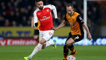 Arsenal's Olivier Giroud and Hull City's David Meyler battle for the ball (Tim Goode/PA Wire)