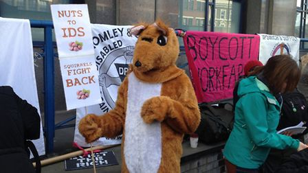 A protester dressed as a squirrel outside City Road Medical Centre