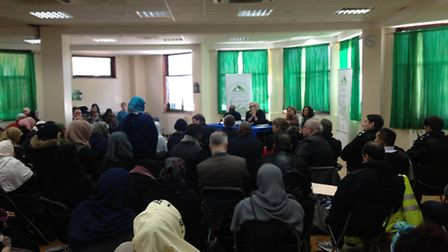 A woman, standing, addresses Jeremy Corbyn about Islamophobia in Finsbury Park Mosque today. Picture