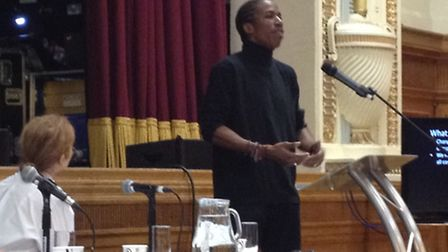 Junior Smart, founder of the SOS Gangs Project, addresses the Islington crime summit in the Assembly
