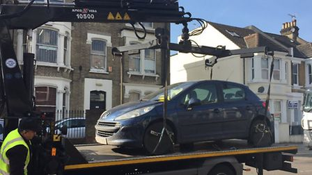 The car was towed away from Tavistock Road by police and council officers (Pic: @Twitter MPSDuddenHi