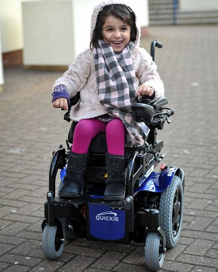 Saina Sobate, four, with her new wheelchair