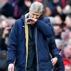 Arsenal manager Arsene Wenger looks downcast after his side's 3-2 defeat at Old Trafford