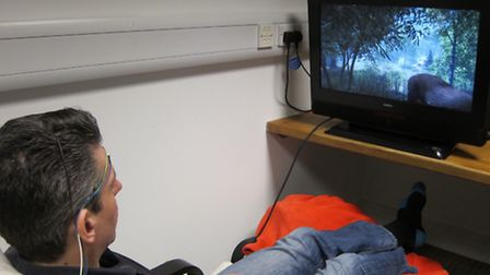 Martin Bauer exercises his brain on Saturday with the video game treatment