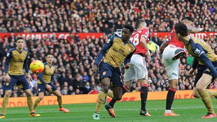 Danny Welbeck scores a goal for Arsenal. (Photo by David Price/Arsenal FC via Getty Images)