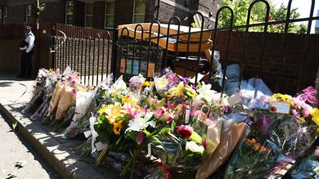 Tragic: Tributes to Stefan laid out in Caldy Walk following his death (Picture: Ken Mears)