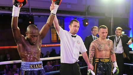 Kian Thomas (blue shorts) defeats JP McGuiness at the Camden Centre in December. Pic: Philip Sharkey