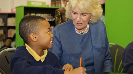 The Duchess of Cornwall chats to a Laycock Primary School pupil during her visit to Islington Centra