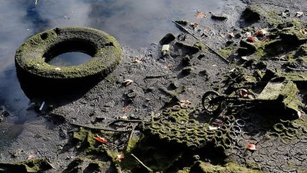 A tyre dumped in the canal (Photo by Bethany Clarke/Getty Images for The Canal & River Trust)