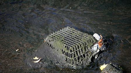 A shopping basket dumped in the Regent's Canal (Photo by Bethany Clarke/Getty Images for The Canal &