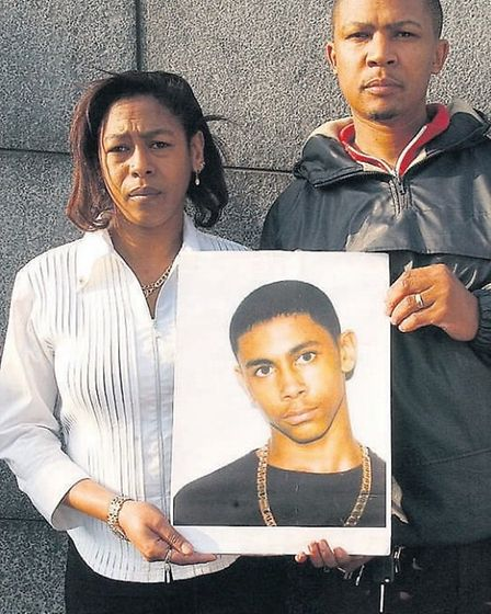 Vanessa Hyman and Delroy Elliot with a picture of Anton