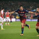Barcelona's Luis Suarez (centre) celebrates scoring their second goal against Arsenal with team-mate