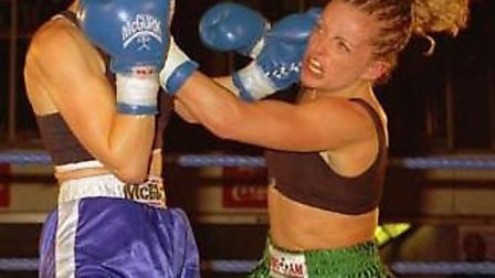 Cathy Brown, right, during her boxing days