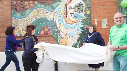 Cllr Lesly Jones and artist Debra Collis join members of Willesden Town Team to unveil Eartha, the m
