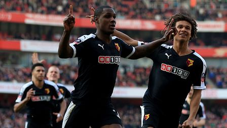 Watford's Odion Ighalo (left) celebrates scoring his side's first goal against Arsenal