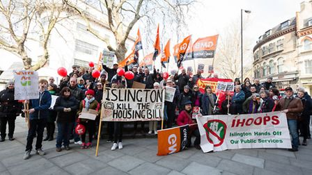 Islington residents and supporters gather outside the former Clerkenwell fire station as they prepar
